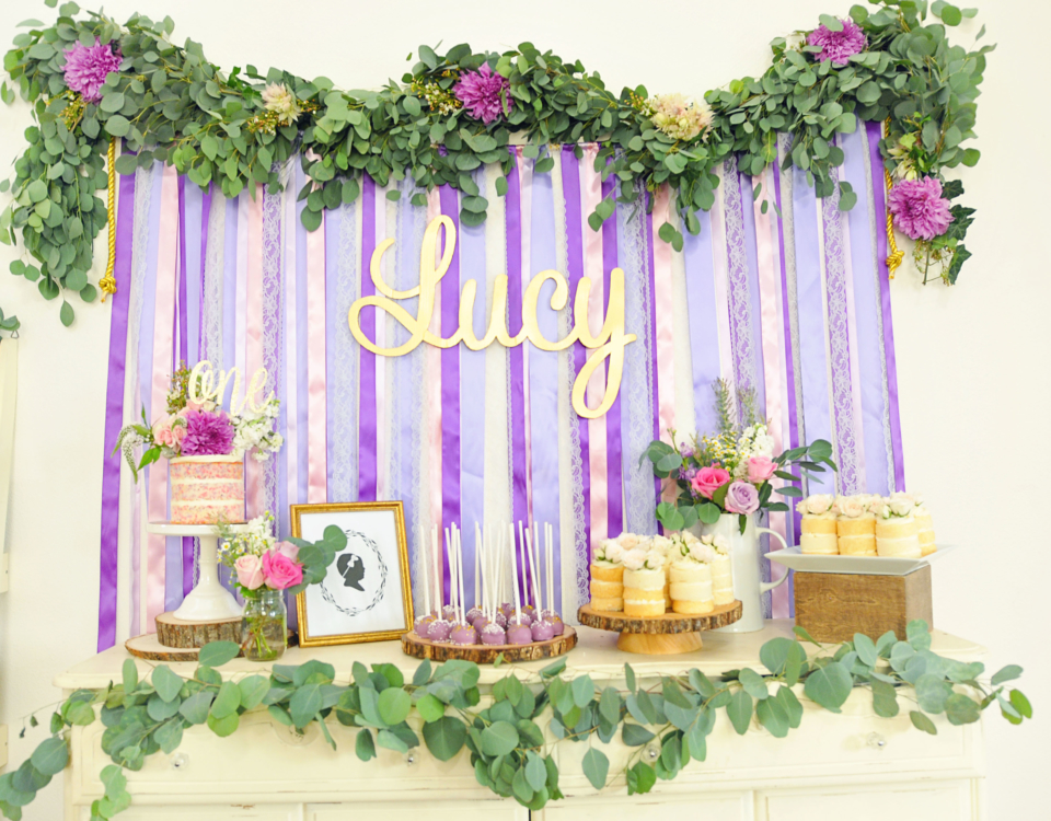 Smash Cake SoCal | Purple Ribbons & Roses 1st Birthday, floral garland, naked cake, mini cakes, cake pops, confetti cake, vintage, ribbon backdrop, gold, glitter cake topper