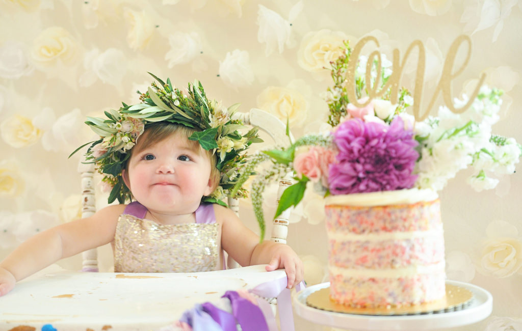 Smash Cake SoCal | Purple Ribbons & Roses 1st Birthday, floral crown, vintage high chair, naked cake, glitter one cake topper, confetti cake