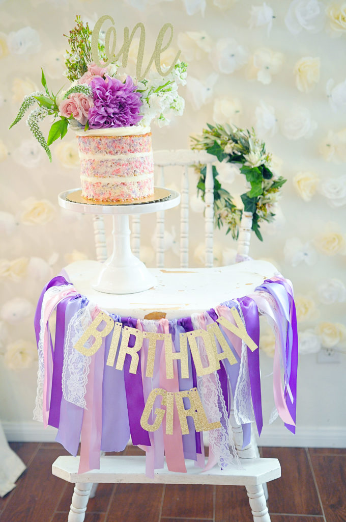 Smash Cake SoCal | Purple Ribbons & Roses 1st Birthday, naked cake, confetti cake, floral crown, vintage highchair, glitter one cake topper, glitter banner