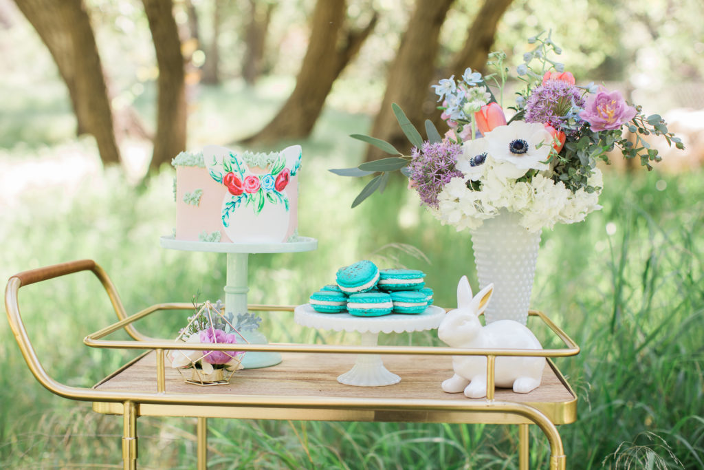 Smash Cake SoCal | Whimsical Wooded Easter Egg Hunt, Stylized Shoot, woods, bunny, table setting, magical, floral crowns, childrens party, easter cake, bunny cake, rabbit cake, macarons, robin egg macarons, blue, terrarium flower arrangement, gold bar cart