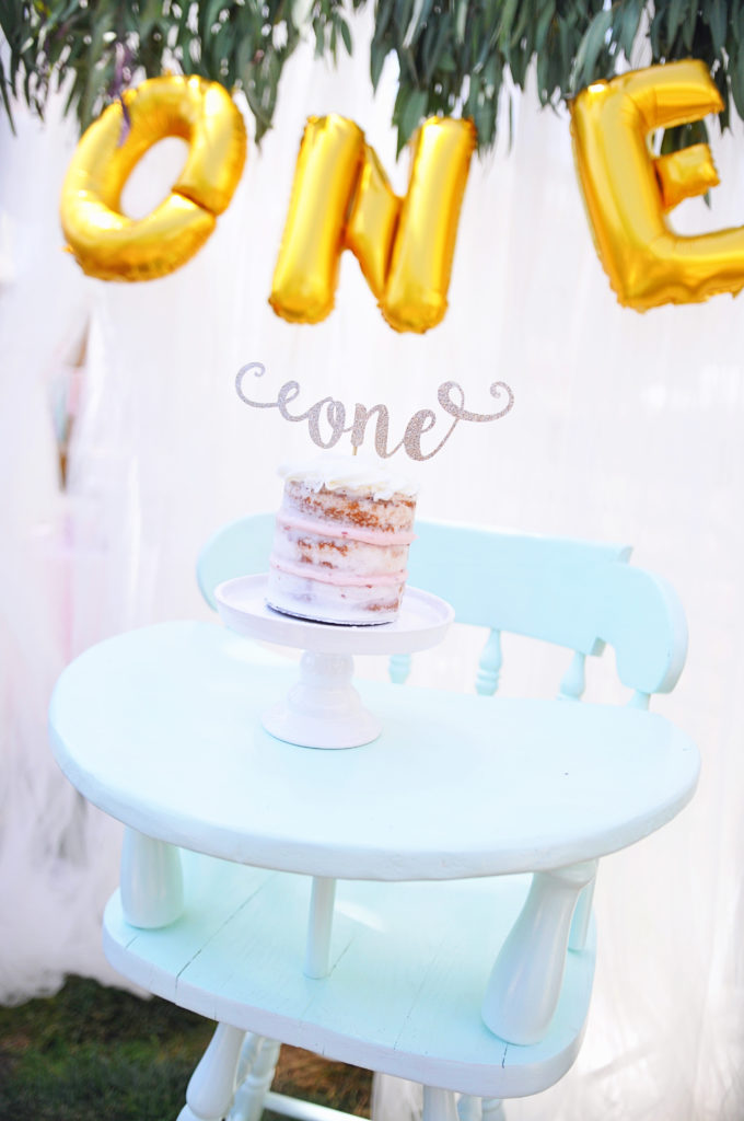 Smash Cake SoCal | Bohemian Unicorn 1st Birthday, boho, unicorn, pink, balloon garland, dream catcher, unicorn cake, unicorn head, hand lettering, chalk sign, unicorn horn cupcakes, balloon centerpiece, tulle backdrop, Photo Booth backdrop, backdrop with greens, balloon backdrop